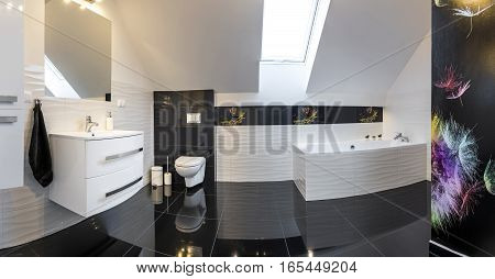 Panoramic view of modern design comfortable bathroom in black and white style
