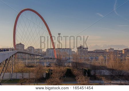 Italy Turin - January 5 2015: view of Olympic Arch of Turin buildings and mountains on backgrioun Lingotto district on January 05 2015 in Turin Italy.