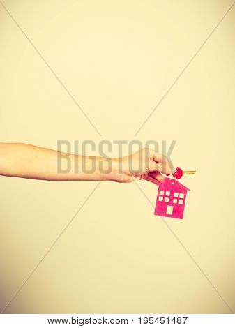 Person Holding Keys With Pendant In House Shape