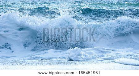 Marine foamy wave. Costa Brava in winter.