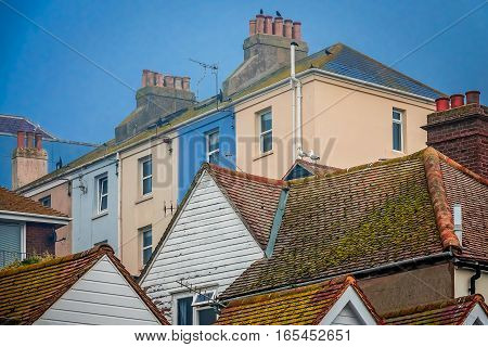 Colorful houses on a hillside in the old town of Hastings, East Sussex, England, UK