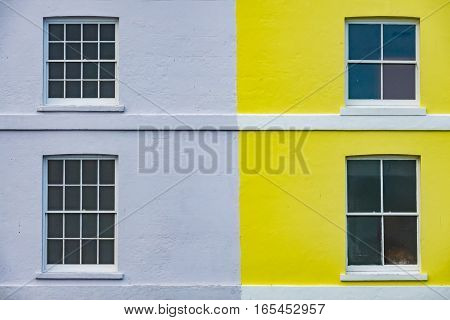 Colorful yellow and blue home facade in Hastings, England, UK