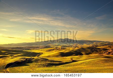Volterra winter panorama rolling hills and green fields on sunset. Tuscany Italy Europe