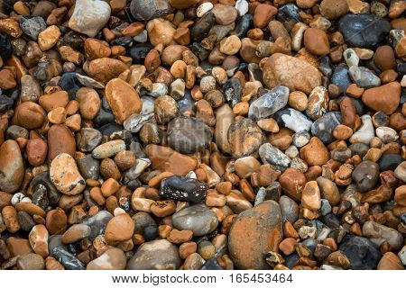 Picture of a pile of peebles on the ground on the beach