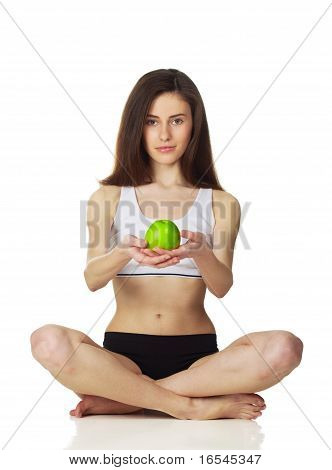 Girl In The Lotus Positions With Apple Looking Streight