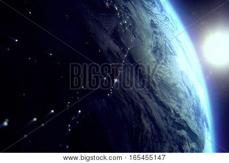 planet earth from the space at night with sun near on black background