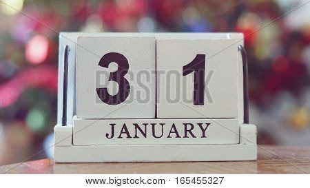 JANUARY 31 CALENDAR DAY on wooden cube calendar on blur colorful bokeh background vintage style