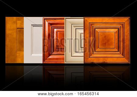 a traditional door samples made of maple and cherry woods, on black background