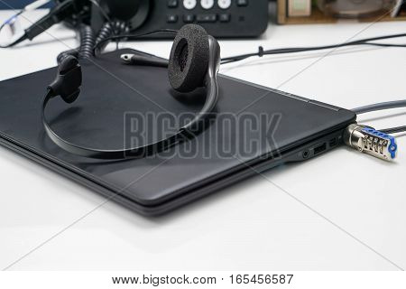 close up black headset on laptop computer