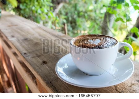A cup of coffee on the wood terrace