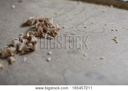 wooden table and sawdust after drilling wood