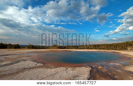Turquoise Pool under cirrus cumulus cloudscape in the Midway Geyser Basin in Yellowstone National Park in Wyoming USA
