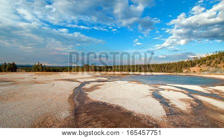 Turquoise Pool under afternoon cloudscape in the Midway Geyser Basin in Yellowstone National Park in Wyoming USA