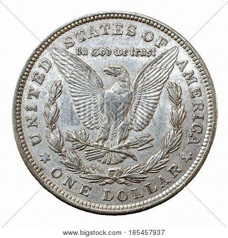 A macro shot of a Morgan Dollar silver coin reverse.
