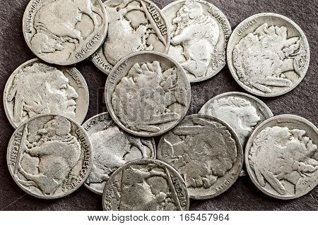 A collection of old circulated buffalo nickels.