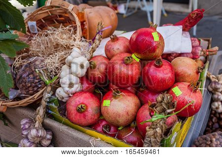 Autumn fruits and vegetables on sale in market stall.