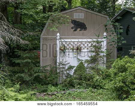 A shed with a silhouette of a bear.