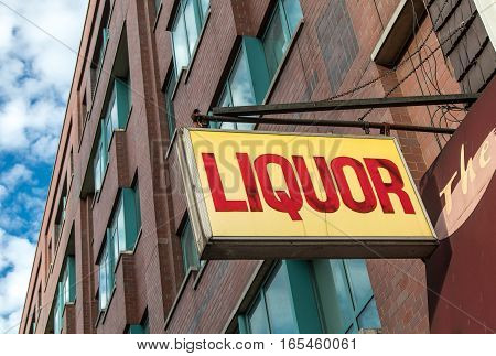A liquor store sign attached to a building.