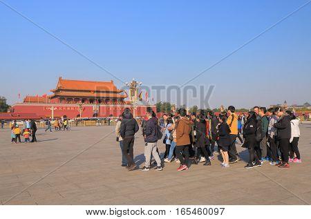 BEIJING CHINA - OCTOBER 29, 2016: Unidentified tour group visit Tiananmen Square.