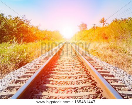 Closeup railway with blue sky and Lens Flare or sunspot