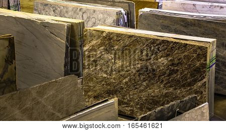 Polished granite and marble slabs. Slabs can be used as a kitchen counters and vanity tops for bathroom. They can be used for floor tile products too.