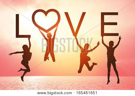 Happy valentines card. Silhouette of children girl jumping on tropical beach with fantastic sunset sky background. Kids holding the word LOVE with sea and sunrise background.