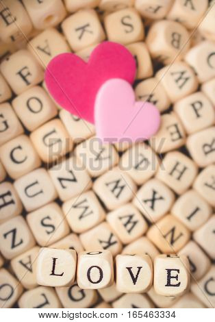 Two Hearts with Word Love in Alphabet Background Vintage Tone Valentine's Day