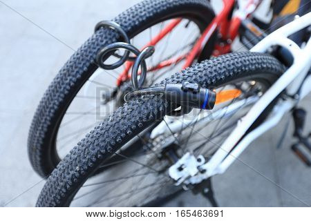 closeup of two bikes locked together for security