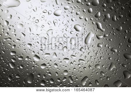 Water drops on dark wall and light water drop for background and design