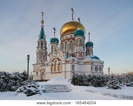 Center of the city of Omsk Cathedral Square the Holy Dormition Cathedral of the winter cold snowy afternoon. Western Siberia Russia.