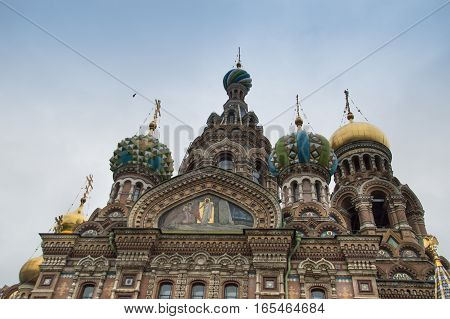 Exterror of  Russian Orthodox Church,  the Church of Our Savior on Spilled Blood, with multi-colored onion domes and murals on the facade. Located in St. Petersburg Russia.