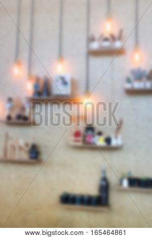 Blurred vintage hanging light bulb on the wall stock photo