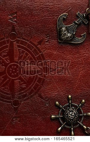Macro of leather surface with sea signs and compass