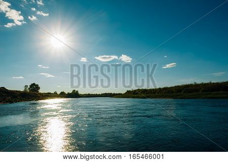 Landscape With The River In The Evening On A Sunset Background