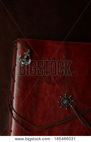 Retro travel notebook with leather cover and compass on top