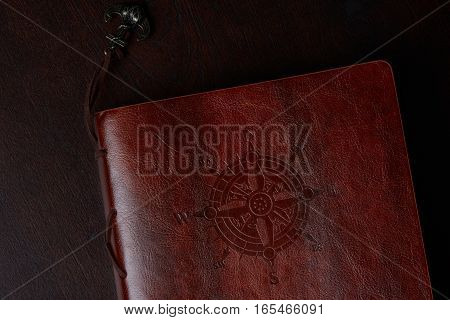 Leather book cover with sea ocean navigation travel background