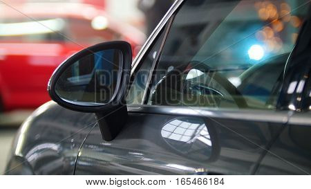 Car auto service - luxury car standing in opposite of welding repairing process, telephoto