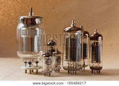 composition of electronic vacuum tubes on kraft paper background