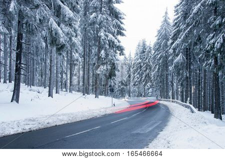 Winter Forest Road - Mountain Road Covered by Snow. Winter Theme. Winter landscape.
