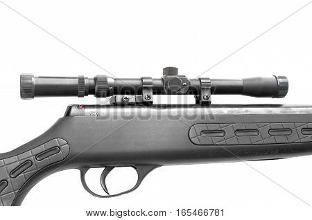 black scope close up on old sniper rifle isolated on white