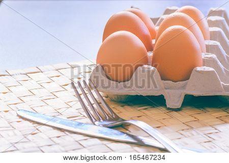 Chicken eggs on the table. Fresh dynamic start.