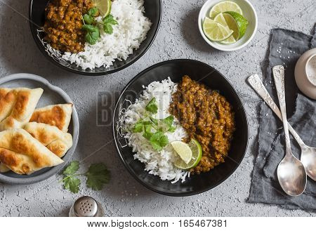 Cream coconut lentil curry with rice and naan bread - vegetarian lunch. Top view flat lay. Vegetarian healthy food concept