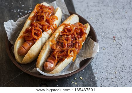 Hot dog with New York street style tomato onion sauce on a wooden background