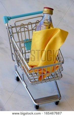 Shopping trolley with a bottle of whiskey in a shroud.