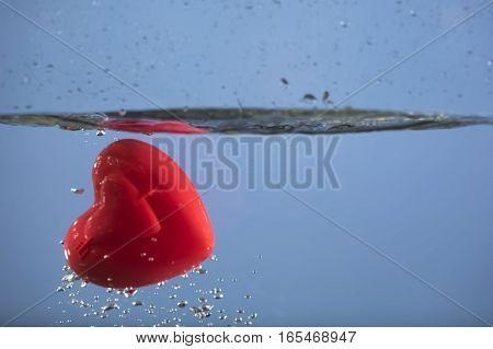 Heart splashing in water as a romantic gesture