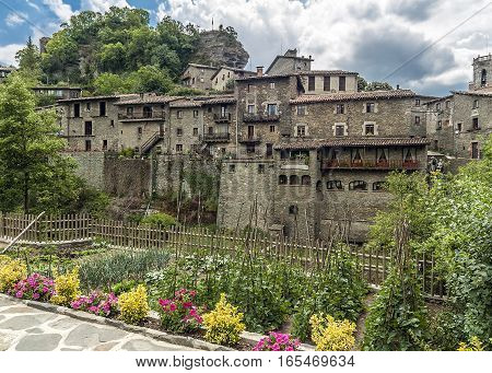 Spain Catalonia . Rupit - mountain village built on top of the basalt rocks in the national park of volcanic origin at an altitude of nine hundred meters above sea level .