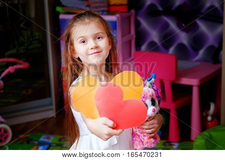 Valentine's day little girl at home hearts