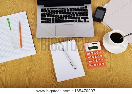 Mock up objects such as computer calculator and smartphone on a wooden background front view