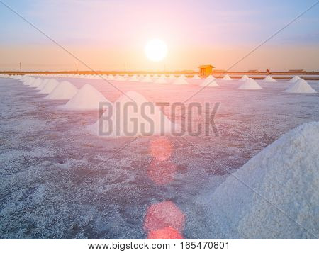 salt pan or salt field with blue sky background and Lens Flare or sunspot