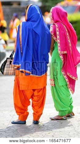 Two Women With Multicolored Clothing